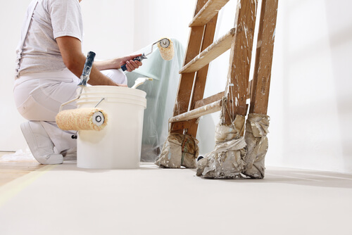 Painter and decorator with ladders